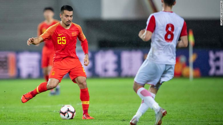 China's Nico Yennaris (left), known as Li Ke in Chinese, plays in friendly match in Guangzhou, in China's southern Guangdong province on June 11, 2019.
