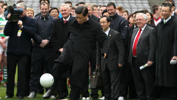 Xi Jinping, then the Chinese vice-president, kicks a  football in Dublin, in February 2012.