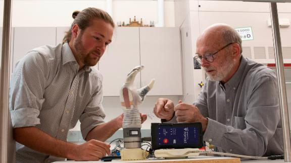 University of Utah biomedical engineering doctoral student Jacob George, left, and associate professor Gregory Clark, are helping develop a prosthetic arm that can move via the wearer