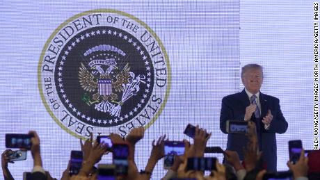 President Donald Trump applauds in front of a doctored presidential seal as he arrives to address the Teen Student Action Summit July 23, 2019 in Washington, DC.