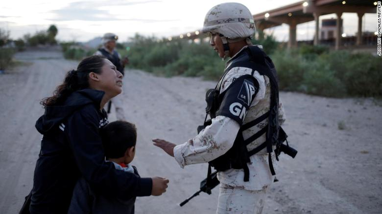 Guatemalan migrant Lety Perez embraces her son Anthony while asking a member of the Mexican National Guard to let them cross into the United States, as seen from Ciudad Juarez, Mexico July 22, 2019. REUTERS/Jose Luis Gonzalez