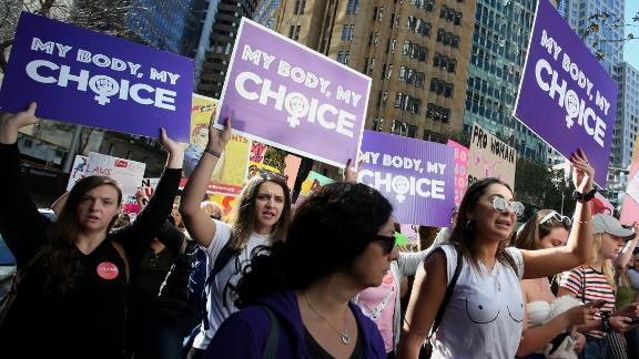 Protesters hold signs and chant during a rally for reproductive rights on June 9, 2019, in Sydney, Australia.