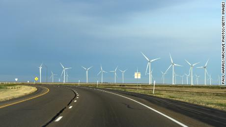 Windmills spin near Adrian, Texas, next to Interstate 40.