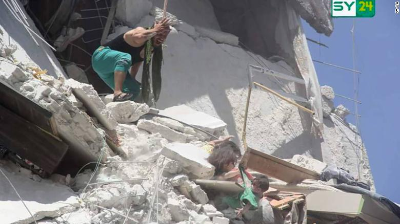 Girl Saving Baby Sister in Syria after Airstrike