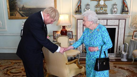 The Queen welcomes Boris Johnson at Buckingham Palace, where she formally invited him to become Prime Minister in July 2019. Johnson won the UK's Conservative Party leadership contest and replaced Theresa May, who was forced into resigning after members of her Cabinet lost confidence in her inability to secure the UK's departure from the European Union.