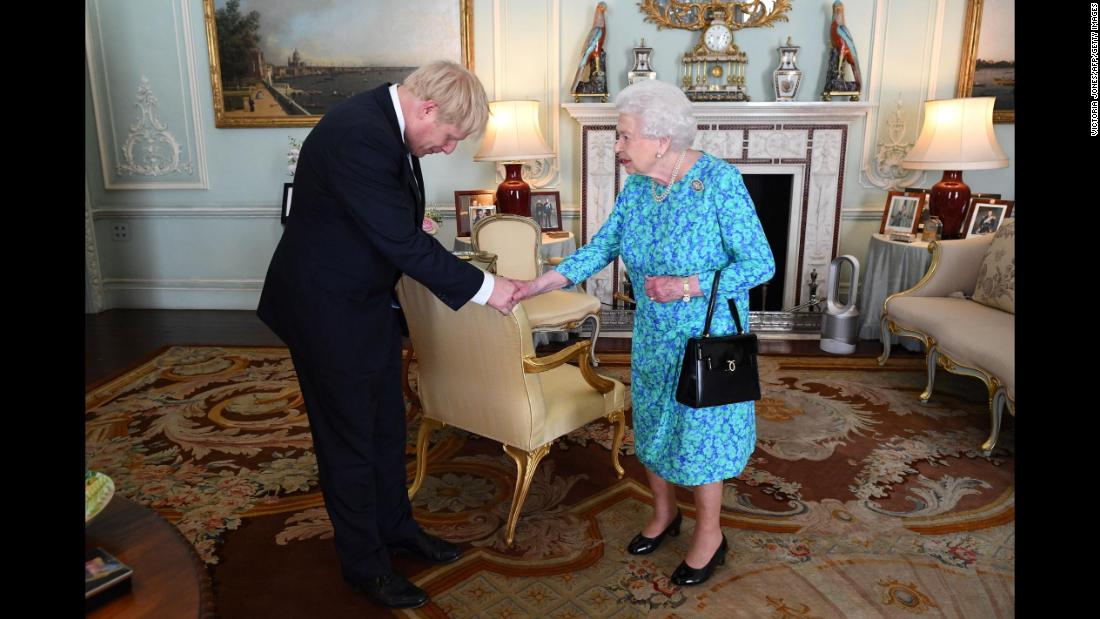 "The Queen welcomes Boris Johnson at Buckingham Palace, where she formally invited him to become Prime Minister in July 2019. Johnson <a href=""https://edition.cnn.com/2019/07/23/uk/boris-johnson-prime-minister-uk-gbr-intl/index.html"" target=""_blank"">won the UK's Conservative Party leadership contest</a> and replaced Theresa May, who was forced into resigning after members of her Cabinet lost confidence in her inability to secure the UK's departure from the European Union."