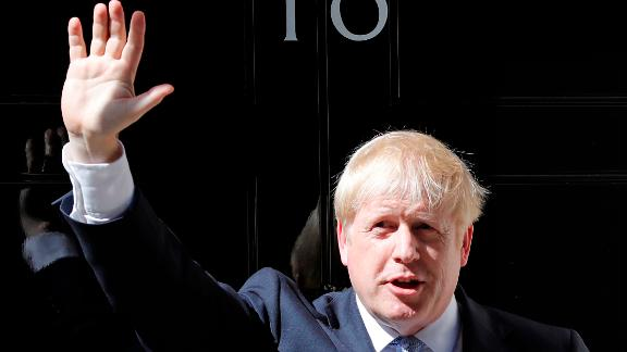 Britain's new Prime Minister Boris Johnson waves from the steps outside 10 Downing Street, London, Wednesday, July 24, 2019. Boris Johnson has replaced Theresa May as Prime Minister, following her resignation last month after Parliament repeatedly rejected the Brexit withdrawal agreement she struck with the European Union. (AP Photo/Frank Augstein)