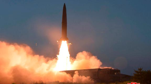 """This Thursday, July 25, 2019, photo provided on Friday, July 26, 2019, by the North Korean government shows a test of a missile launch in North Korea.  A day after two North Korean missile launches rattled Asia, the nation announced Friday that its leader Kim Jong Un supervised a test of a new-type tactical guided weapon that was meant to be a """"solemn warning"""" about South Korean weapons introduction and its rival's plans to hold military exercises with the United States. Independent journalists were not given access to cover the event depicted in this image distributed by the North Korean government. The content of this image is as provided and cannot be independently verified. Korean language watermark on image as provided by source reads: """"KCNA"""" which is the abbreviation for Korean Central News Agency. (Korean Central News Agency/Korea News Service via AP)"""