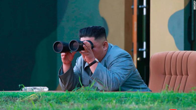 In this Thursday, July 25, 2019, photo provided on Friday, July 26, 2019, by the North Korean government, North Korean leader Kim Jong Un watches a missile test in North Korea.