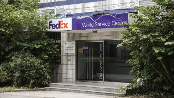 "Signage is displayed atop a FedEx Corp. service center in Shanghai, China, on Sunday, June 2, 2019. China targeted FedEx Corp. in its escalating trade war with the U.S., giving a hint of the kind of foreign companies it may blacklist as ""unreliable."" Photographer: Qilai Shen/Bloomberg via Getty Images"