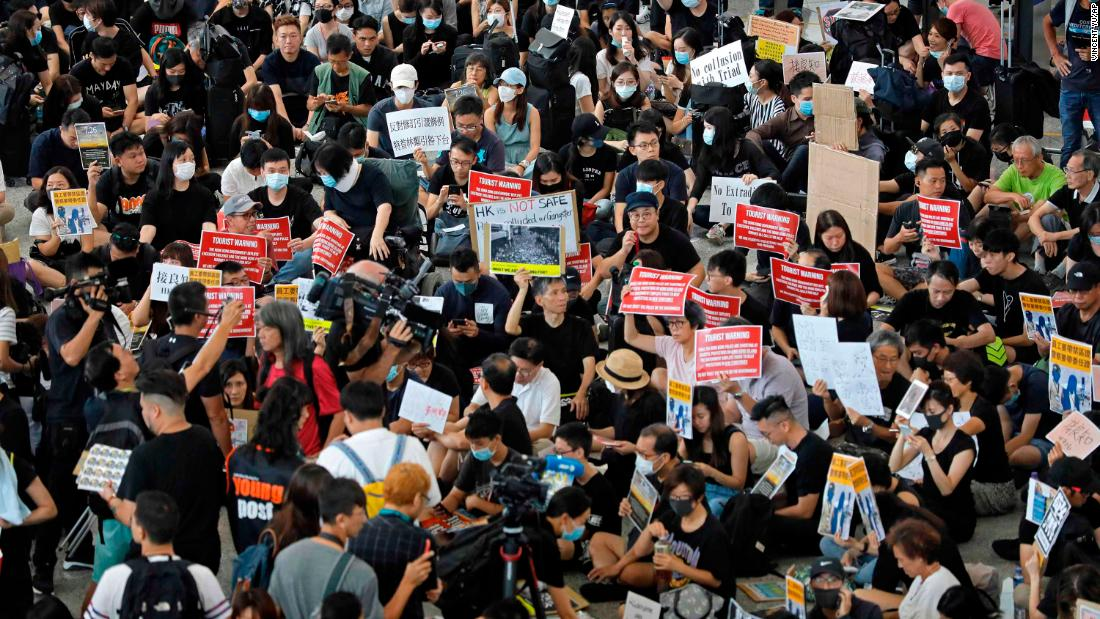 Demonstrators stage protest at the Hong Kong International Airport on Friday.