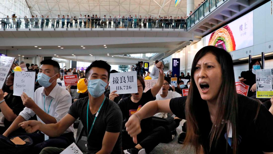 Protesters shout slogans during the protest at the airport.