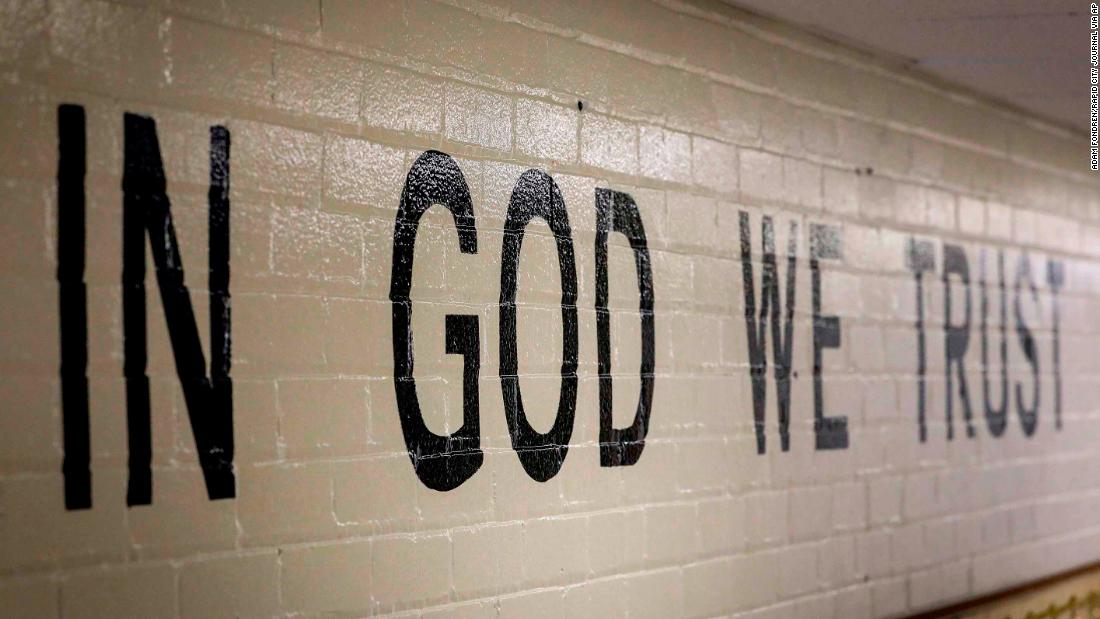 Public schools all over South Dakota are putting up mandated 'In God We Trust' signs