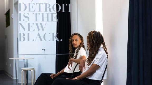 DETROIT, MICHIGAN - July 24, 2019: Owner and founder Roslyn Karamoko, 34, at Detroit is the New Black in Downtown Detroit, Mich., on Tuesday, July 23, 2019. The space also houses merchandise from other artists, entrepreneurs and fashion designers of color. (Brittany Greeson for CNN)
