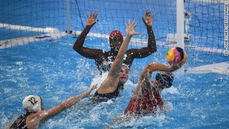 Spain's Maria Pena Carrasco throws the ball and US goalkeeper Ashley Johnson moves to block him during the women's final.