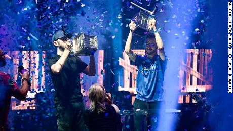 Jul 26, 2019; Flushing, NY, USA; RL Grime (left) and Airwaks (right) celebrate after winning the Pro-AM at the Fortnite World Cup Finals e-sports event at Arthur Ashe Stadium. Mandatory Credit: Catalina Fragoso-USA TODAY Sports
