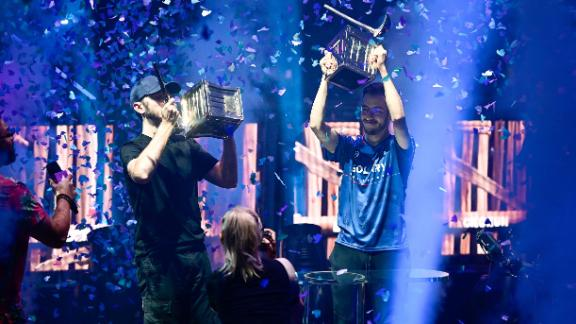 Jul 26, 2019; Flushing, NY, USA; RL Grime (left) and Airwaks (right) celebrate after winning the Pro-AM during the Fortnite World Cup Finals e-sports event at Arthur Ashe Stadium. Mandatory Credit: Catalina Fragoso-USA TODAY Sports