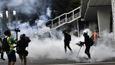 Hong Kong police fire tear gas during demonstration in the district of Yuen Long in Hong Kong on July 27, 2019. - Crowds of Hong Kong protesters defied a police ban and began gathering in a town close to the Chinese border to rally against suspected triad gangs who beat up pro-democracy demonstrators there last weekend. (Photo by Anthony WALLACE / AFP)        (Photo credit should read ANTHONY WALLACE/AFP/Getty Images)