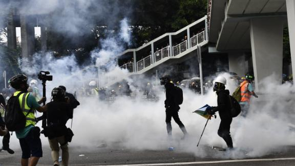 Hong Kong police fire tear gas during demonstration in the district of Yuen Long in Hong Kong on July 27, 2019.