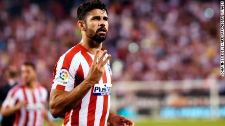 Atletico Madrid's Diego Costa celebrates after scoring his third goal.
