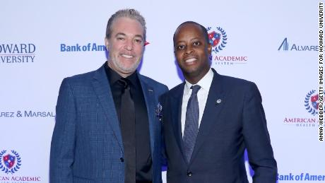 Joel Freedman (left) poses for a photo with Howard University President, Wayne AI Frederick in January 2018. Freedman's company, American Academic Health System, previously led the Howard University Hospital. However, the university announced that it will not renew the contract, which ended in March.