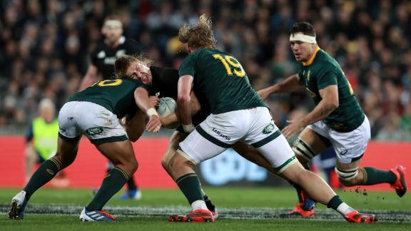Jack Goodhue of the All Blacks charges forward against South Africa.