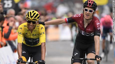 Egan Bernal, wearing the overall leader's yellow jersey, is congratulated by teammate Geraint Thomas.