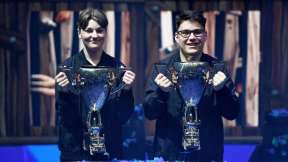 """NEW YORK, NEW YORK - JULY 27: Emil """"Nyhrox"""" Bergquist Pedersen (L) and David """"Aqua"""" Wang (R) pose with the trophy after winning the Duos competition during day two of the Fortnite World Cup Finals at Arthur Ashe Stadium on July 27, 2019 in the Queens borough of New York City. (Photo by Sarah Stier/Getty Images)"""