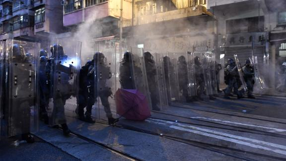 Police officers fire tear gas during a demonstration against what activists say is police violence in Hong Kong on July 28, 2019. - Tens of thousands of pro-democracy protesters defied authorities to hold an unsanctioned march through Hong Kong, a day after riot police fired rubber bullets and tear gas to disperse another illegal gathering, plunging the financial hub deeper into crisis. (Photo by Anthony WALLACE / AFP)        (Photo credit should read ANTHONY WALLACE/AFP/Getty Images)