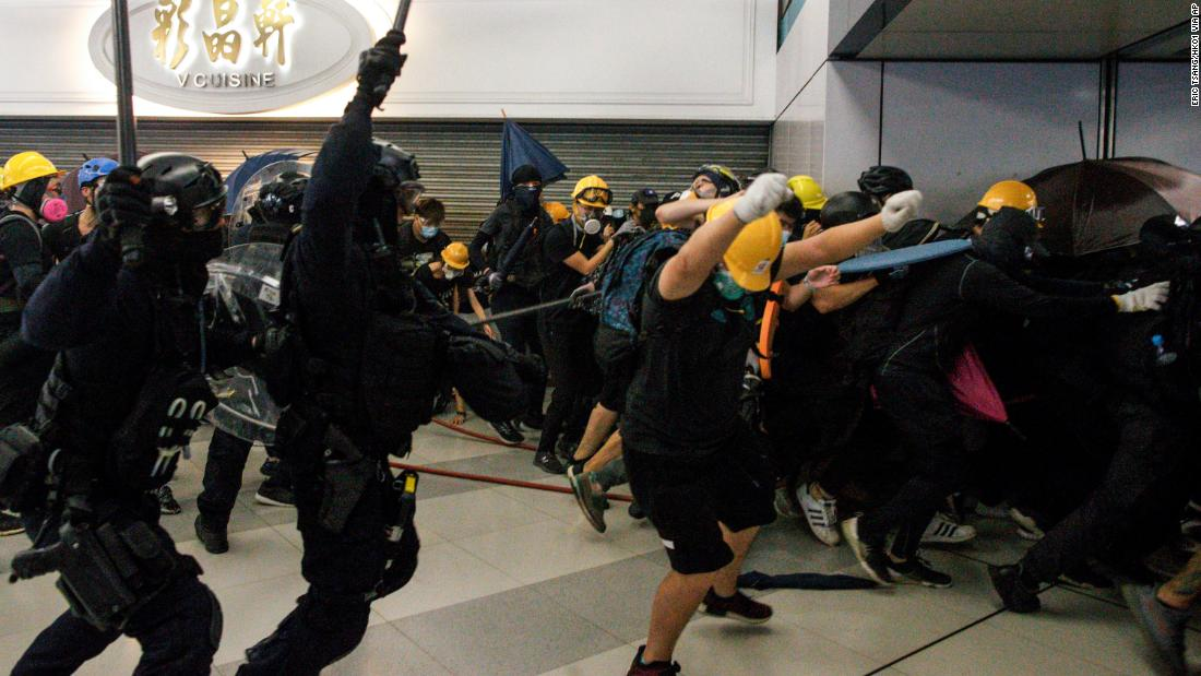 Special Tactical Squad officers clash with protesters who refused to disperse from a train station in Yuen Long on July 27.
