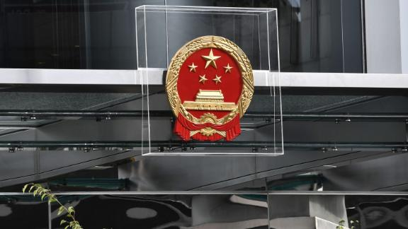 The emblem on the China Liaison Office is protected by plexiglass during a demonstration on Sunday, July 28.