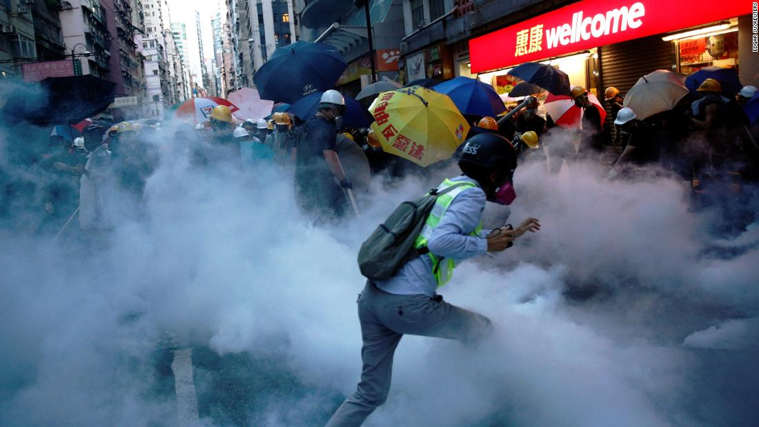 Demonstrators clash with police during a protest near China's Liaison Office in Hong Kong on Sunday, July 28. Thousands of pro-democracy protesters returned to the streets of Hong Kong Sunday, the eighth week of the demonstrations.