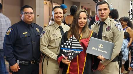 Jessica Ramirez and the El Paso officers at her graduation Saturday.