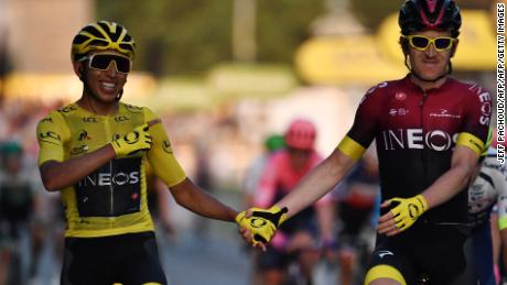 Colombia's Egan Bernal, wearing the overall leader's yellow jersey,  is congratulated by teammate Britain's Geraint Thomas as he celebrates his victory on the finish line of the 21st and last stage of the 106th edition of the Tour de France.