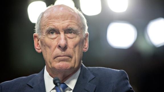 Dan Coats, director of national intelligence, listens during a Senate Intelligence Committee hearing in Washington, D.C., U.S., on Wednesday, June 7, 2017. Coats told associates in March that U.S. President Donald Trump had asked him to intervene with then-Federal Bureau of Investigation Director James Comey to get the FBI to back off its focus on former National Security Adviser Michael Flynn and Russia probe, the Washington Post reported yesterday. Photographer: Andrew Harrer/Bloomberg via Getty Images