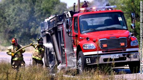Firefighters hose down a Snyder Volunteer Fire Department truck that caught fire on Thursday.
