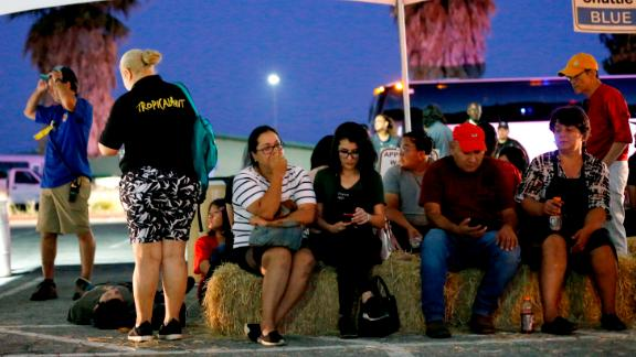 Festival attendees are transported to a reunification center at Gavilan College.