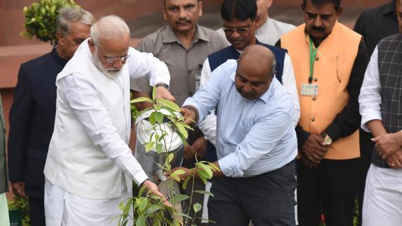 Prime Minister Narendra Modi plants a sapling as part of a wider plantation campaign, in New Delhi, India, July 26, 2019.