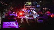 """Police vehicles arrive on the scene of the investigation following a deadly shooting at the Gilroy Garlic Festival in Gilroy, 80 miles south of San Francisco, California on July 28, 2019. - Three people were killed and at least 15 others injured in a shooting at a major food festival in California on Sunday, police said. Officers confronted and shot dead the suspect """"in less than a minute,"""" said Scot Smithee, police chief of the city of Gilroy, 30 miles (48 kilometers) southeast of San Jose. (Photo by Philip Pacheco / AFP)"""