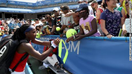 "Cori ""Coco"" Gauff signs autographs after defeating Hiroko Kuwata at the Citi Open."