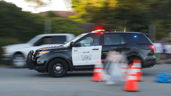 Emergency vehicles head towards the Gilroy Garlic Festival following a shooting in Gilroy, Calif., on Sunday, July 28, 2019. (Nhat V. Meyer/San Jose Mercury News via AP)