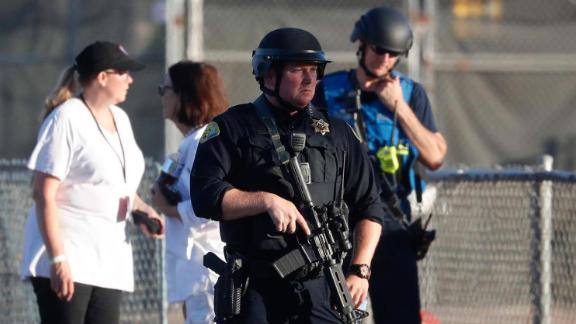 A police officer stands guard at Gilroy High School after the shooting.