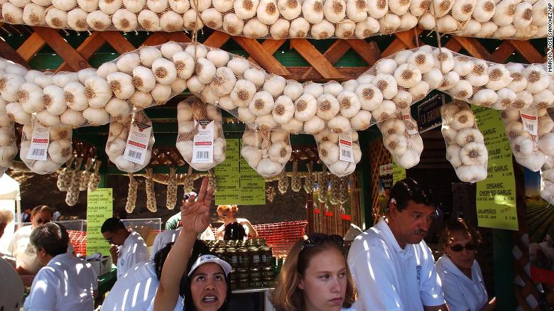 Vendors sell locally-grown garlic at the Gilroy Garlic Festival in Gilroy, Calif., on July 24, 2004.