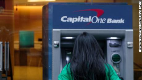 A customer uses an automatic teller machine (ATM) outside of a Capital One Financial Corp. bank branch in New York, U.S., Wednesday, Jan. 9, 2019. Capital One Financial Corp. is scheduled to release earnings figures on January 22. Photographer: Sarah Blesener/Bloomberg via Getty Images