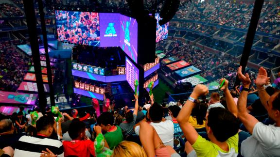 Fans cheer during the final of the Solo competition at the 2019 Fortnite World Cup July 28, 2019 inside of Arthur Ashe Stadium, in New York City. (Photo by Johannes EISELE / AFP)        (Photo credit should read JOHANNES EISELE/AFP/Getty Images)