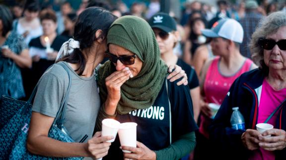 Hina Moheyuddin, left, comforts Noshaba Afzal during a vigil for victims of a Sunday evening shooting that left three people dead at the Gilroy Garlic Festival, Monday, July 29, 2019, in Gilroy, Calif. (AP Photo/Noah Berger)