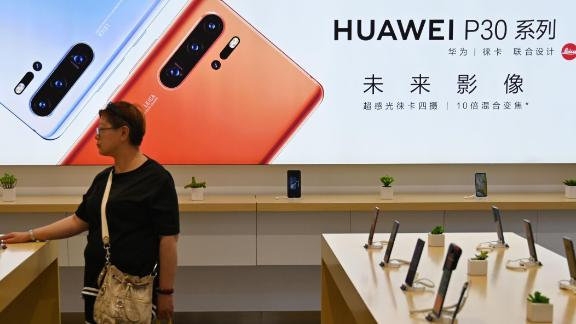 People browse for items in a Huawei store in Shanghai on May 24, 2019.