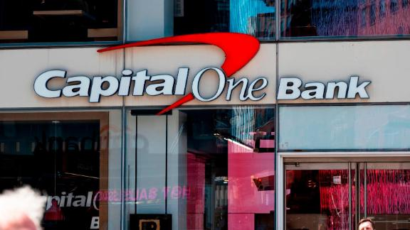 People walk past a branch of the Capital One Bank on April 17, 2019 in New York City. (Photo by Johannes EISELE / AFP)        (Photo credit should read JOHANNES EISELE/AFP/Getty Images)