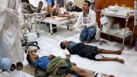 People injured by an explosion in a market in Yemen's Saada province receive medical attention at the local Al Jomhouri hospital.