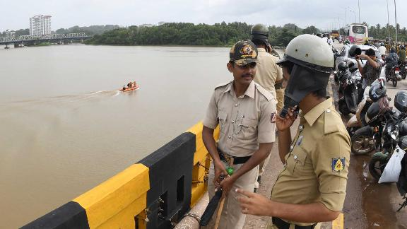 Police at the Netravati river in Mangalore, southern India, as search teams look for Indian coffee tycoon V.G. Siddhartha.
